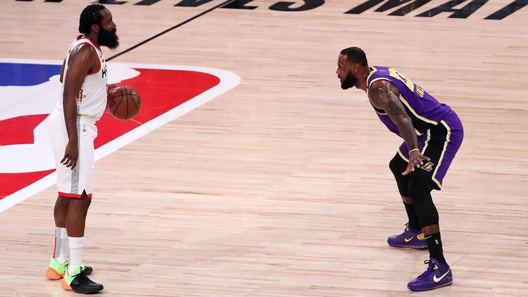 James Harden of the Houston Rockets dribbles the ball against LeBron James of the Los Angeles Lakers during the first quarter in Game One of the Western Conference semi-finals