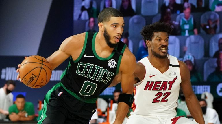 Jayson Tatum of the Boston Celtics handles the ball against Jimmy Butler of the Miami Heat during Game One of the Eastern Conference Finals