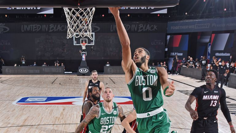 Jayson Tatum of the Boston Celtic drives to the basket against the Miami Heat during Game Four of the Eastern Conference Finals
