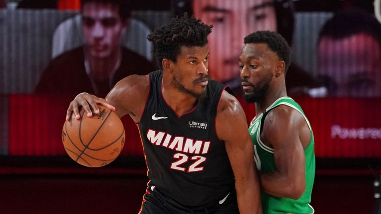Jimmy Butler of the Miami Heat handles the ball against Kemba Walker of the Boston Celtics during Game Four of the Eastern Conference Finals