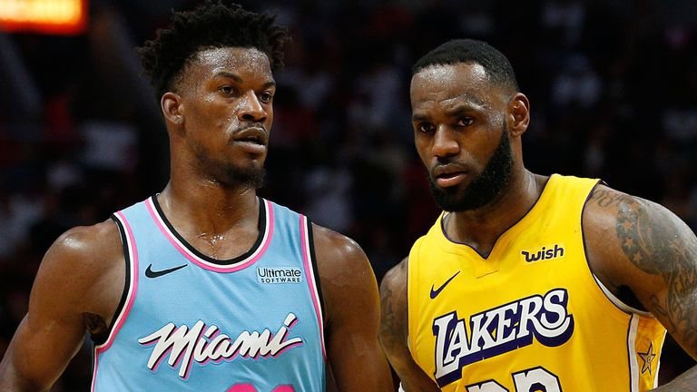 Jimmy Butler and LeBron James pictured together on court for the Miami Heat and Los Angeles Lakers