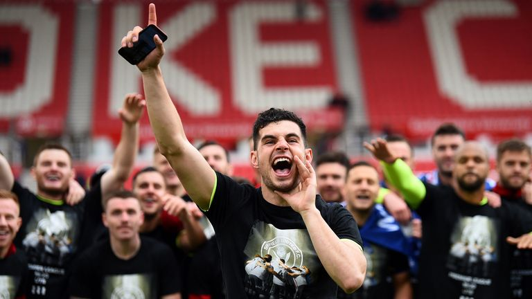 John Egan leads the Sheffield United fans in song at Stoke in the final game of their promotion season