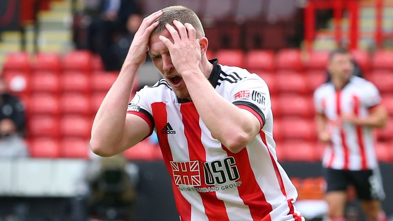 John Lundstram reacts after seeing his shot saved