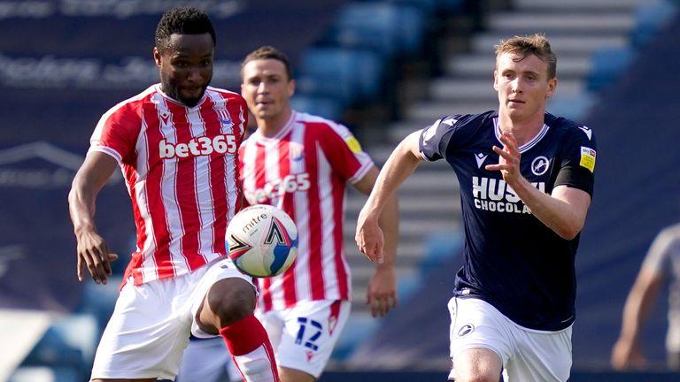 Stoke City's John Obi Mikel and Millwall's Jon Dadi Bodvarsson battle for the ball