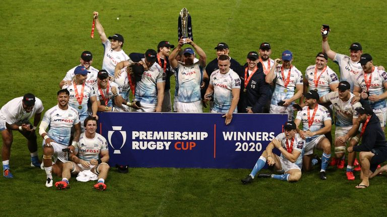 Sale skipper Jono Ross lifts the Premiership Cup trophy with his teammates
