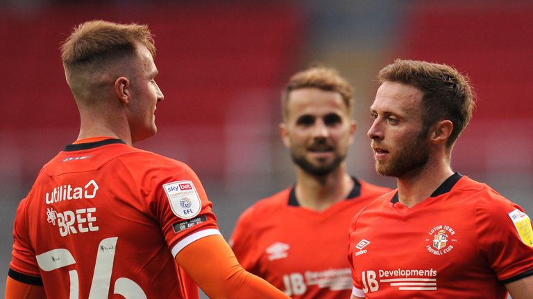 Jordan Clark's fine header set up Luton's third-round clash with Manchester United