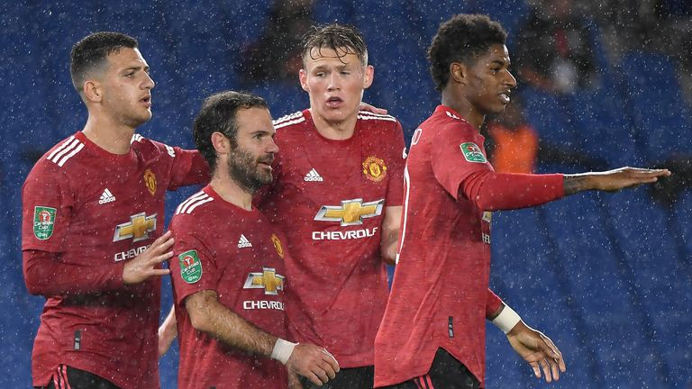 Juan Mata celebrates with team-mates after putting Manchester United 2-0 up at Brighton