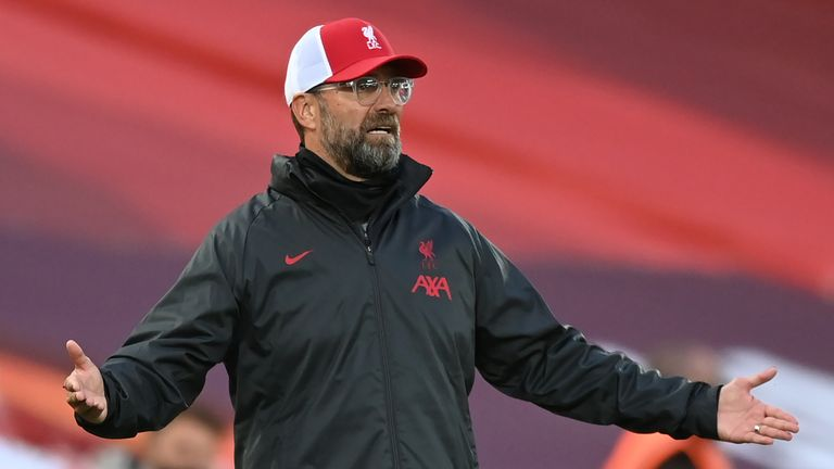Jurgen Klopp gestures on the touchline at Anfield