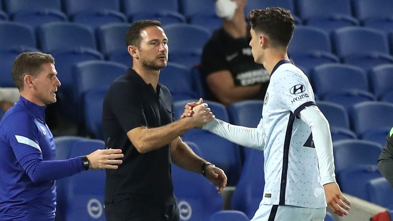 Kai Havertz shakes hands with Frank Lampard as he leaves the pitch