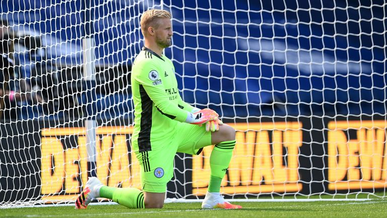Kasper Schmeichel takes a knee before Leicester's opening day match against West Brom