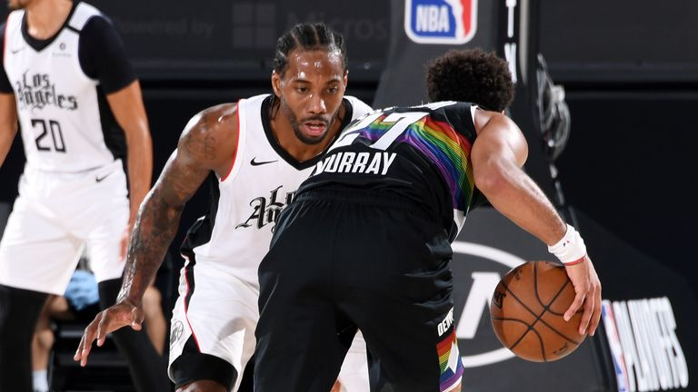 Kawhi Leonard #2 of the LA Clippers plays defense against Jamal Murray #27 of the Denver Nuggets during Game Four of the Western Conference Semifinals