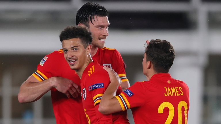 Kieffer Moore of Wales celebrates with team-mates Ethan Ampadu and Daniel James after scoring against Finland