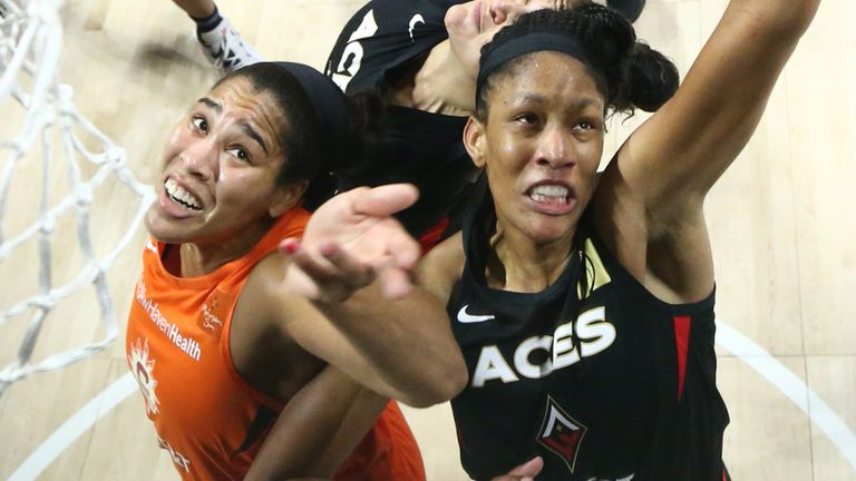 A'ja Wilson grabs a rebound in the Las Vegas Aces' Game 5 win over the Connecticut Sun in Game 5 of the WNBA semi-finals