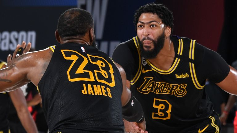 LeBron James and Anthony Davis celebrate during the Lakers' Game 2 victory over the Rockets