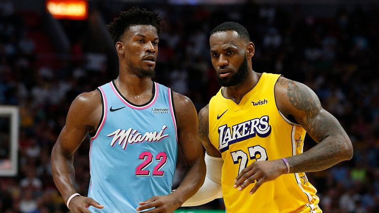 LeBron James #23 of the Los Angeles Lakers guards Jimmy Butler #22 of the Miami Heat during the second half at American Airlines Arena on December 13, 2019