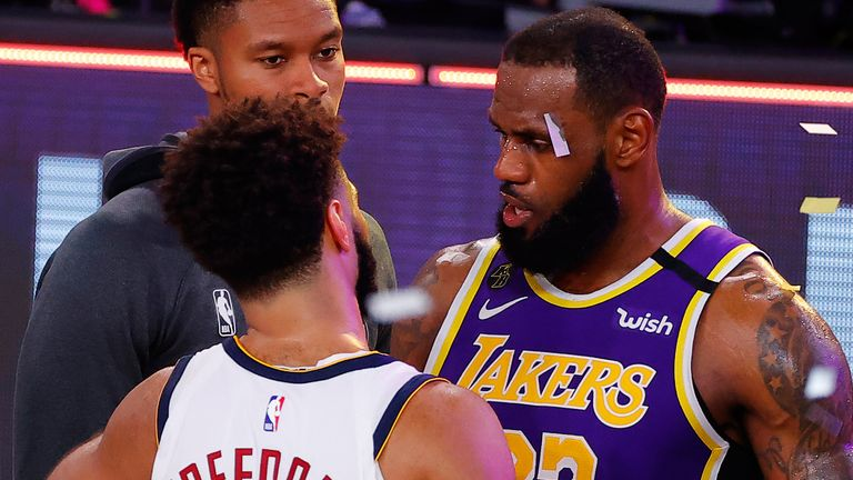 LeBron James embraces Denver guard Jamal Murray after the Lakers eliminated the Nuggets in the Western Conference Finals