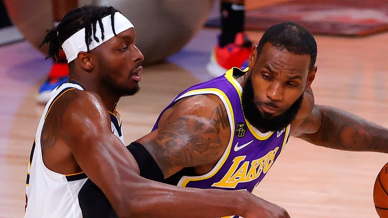 LeBron James backs down Jerami Grant during the Lakers' Game 5 win over the Nuggets