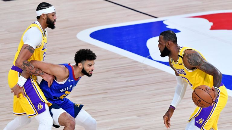 LeBron James of the Los Angeles Lakers handles the ball against Jamal Murray of the Denver Nuggets during Game One of the Western Conference Finals