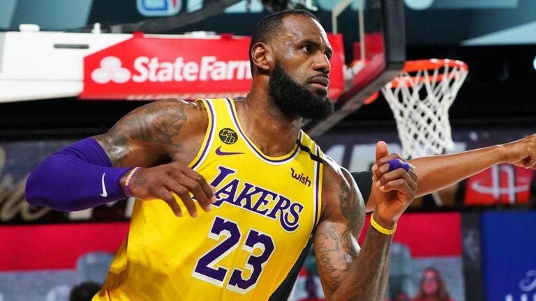 LeBron James runs back on defense after scoring against the Houston Rockets
