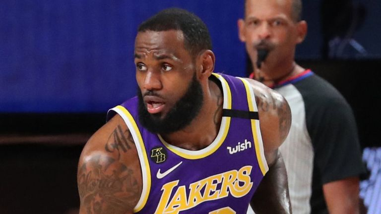 LeBron James controls possession in the Los Angeles Lakers' Game 5win over the Denver Nuggets