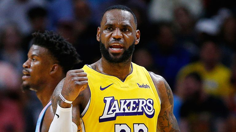 LeBron James celebrates a play against during a Lakers-Heat regular season game