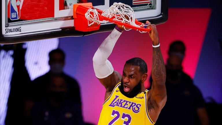 LeBron James of the Los Angeles Lakers dunks against the Denver Nuggets during the second quarter in Game One of the Western Conference Finals