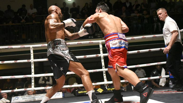 Cello Renda lands a punch on Leon McKenzie with Lee Cook refereeing. Photo credit: Phil Sharkey
