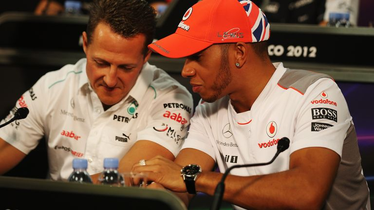 Lewis Hamilton speaks to Michael Schumacher during build-up for the 2012 Monaco GP