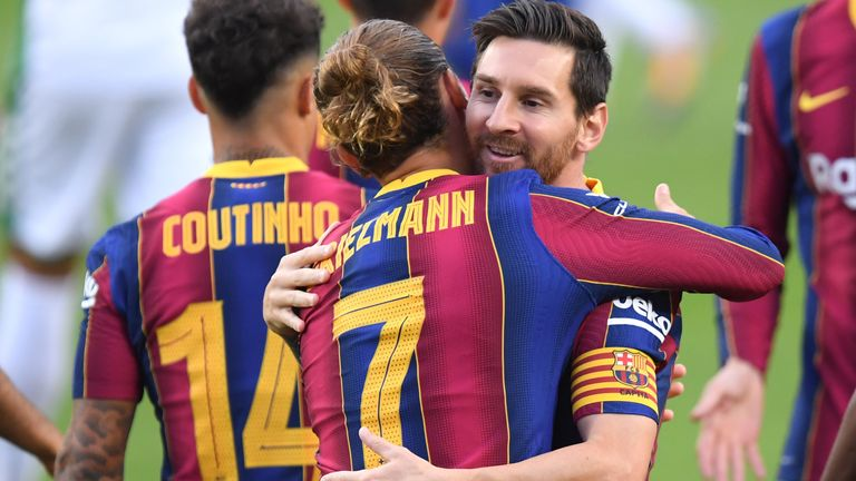 Lionel Messi shares an embrace with Antoine Griezmann during the friendly