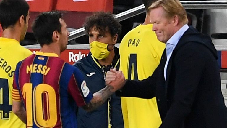 Lionel Messi shakes hands with Ronald Koeman after the game