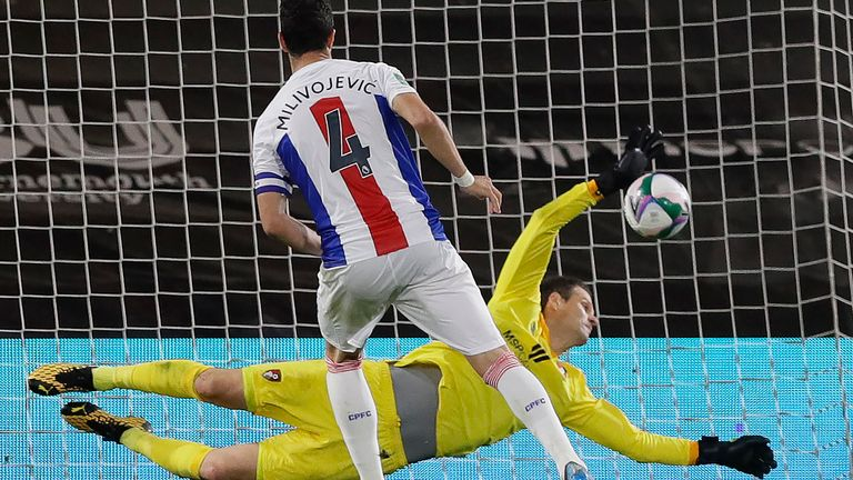 Asmir Begovic saved Luka Milivojevic's second penalty to win the shootout for Bournemouth