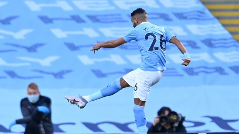 Riyad Mahrez of Manchester City scores his sides first goal during the Premier League match between Manchester City and Leicester City at Etihad Stadium on September 27, 2020 in Manchester, England.