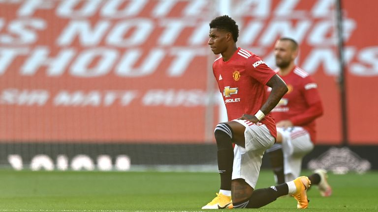 Marcus Rashford takes a knee in support of Black Lives Matter