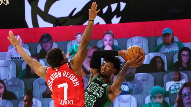 Marcus Smart of the Boston Celtics passes the ball against the Toronto Raptors during Game Three of the Eastern Conference Semifinals
