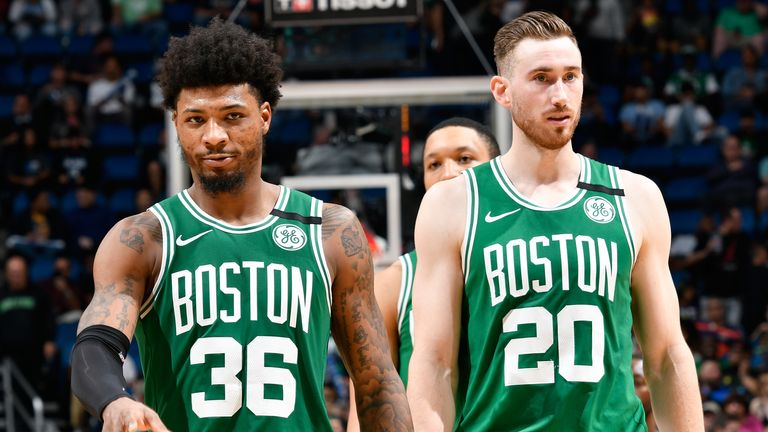 Marcus Smart and Gordon Hayward pictured in regular-season action for the Boston Celtics