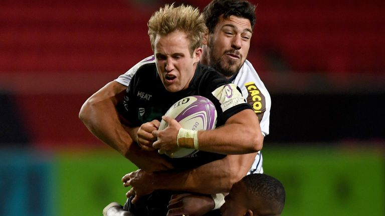 Bristol's Max Malins is tackled by Guido Petti and Cameron Woki of Bordeaux-Begle