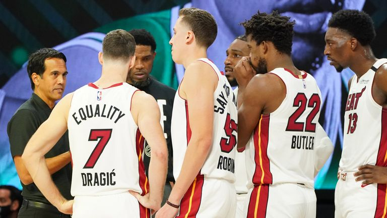 Miami Heat coach Erik Spoelstra talks to his players during a timeout