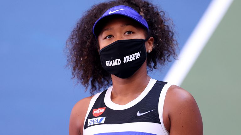 Naomi Osaka of Japan wears a protective face mask with the name, Ahmaud Arbery stenciled on it after winning her Women's Singles third round match against Marta Kostyuk of the Ukraine on Day Five of the 2020 US Open at USTA Billie Jean King National Tennis Center on September 04, 2020 in the Queens borough of New York City. Ahmaud Arbery, an unarmed 25-year-old African-American man, was pursued and fatally shot while jogging in Glynn County, Georgia.
