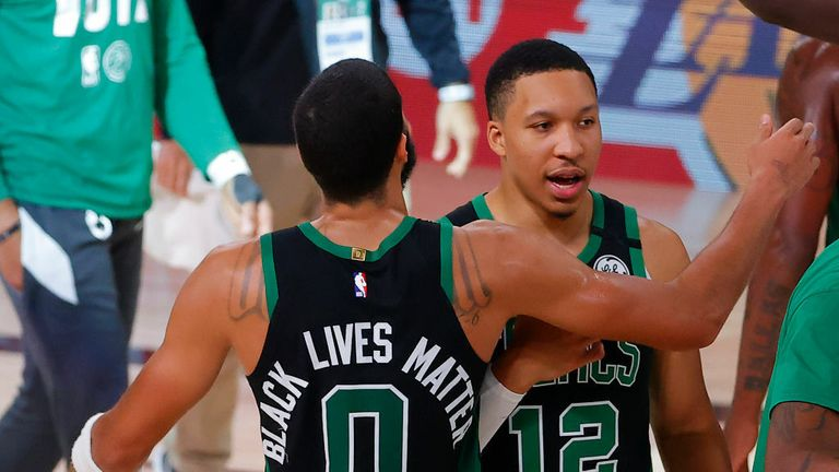 Jayson Tatum #0 of the Boston Celtics and Grant Williams #12 of the Boston Celtics react after their win over the Miami Heat in Game Five of the Eastern Conference Finals during the 2020 NBA Playoffs at AdventHealth Arena at the ESPN Wide World Of Sports Complex on September 25, 2020 in Lake Buena Vista, Florida.