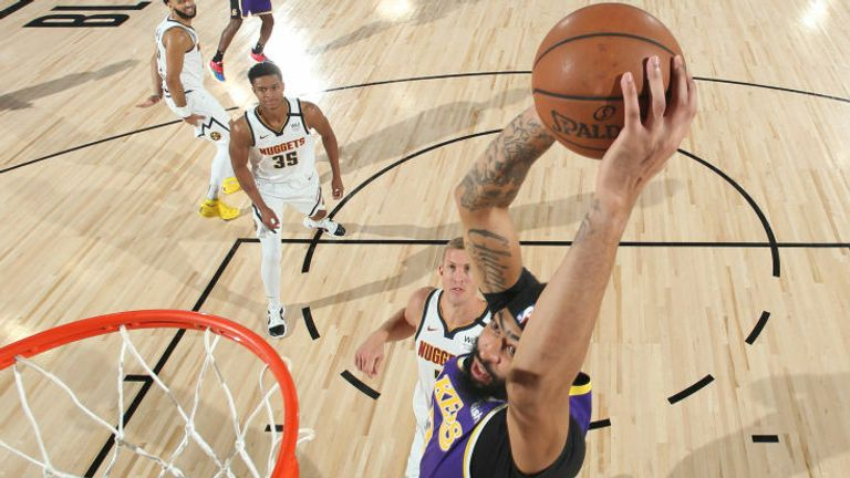 Anthony Davis #3 of the Los Angeles Lakers dunks the ball against the Denver Nuggets during Game Five of the Western Conference Finals of the NBA Playoffs on September 26, 2020 at AdventHealth Arena in Orlando, Florida.