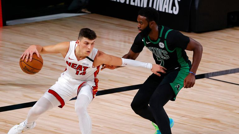 Tyler Herro #14 of the Miami Heat drives the ball against Jaylen Brown #7 of the Boston Celtics during the fourth quarter in Game Two of the Eastern Conference Finals during the 2020 NBA Playoffs at AdventHealth Arena at the ESPN Wide World Of Sports Complex on September 17, 2020 in Lake Buena Vista, Florida.