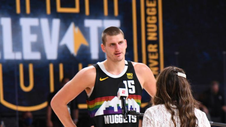 Nikola Jokic #15 of the Denver Nuggets talks with reporter Cassidy Hubbarth after the game during Round One, Game Seven of the NBA Playoffs on September 1, 2020 at AdventHealth Arena in Orlando, Florida.