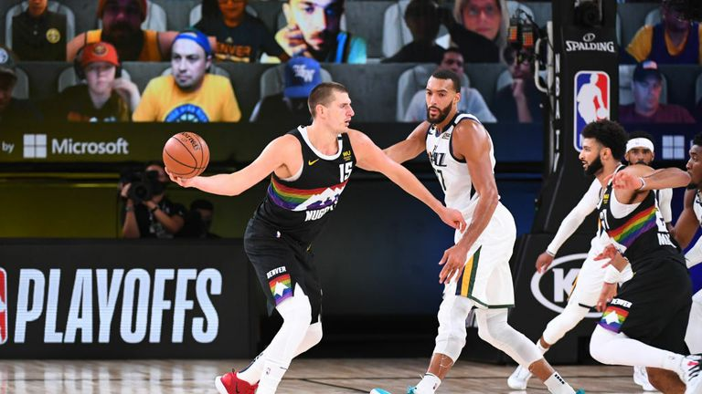 Nikola Jokic #15 of the Denver Nuggets handles the ball against Rudy Gobert #27 of the Utah Jazz during Round One, Game Seven of the NBA Playoffs on September 1, 2020 at the AdventHealth Arena at ESPN Wide World Of Sports Complex in Orlando, Florida.