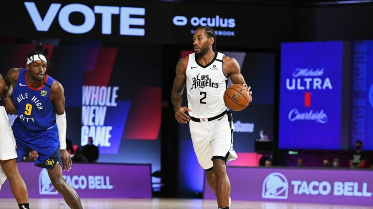 Kawhi Leonard of the LA Clippers dribbles the ball against the Denver Nuggets during Game Five of the Western Conference Semifinals of the NBA Playoffs on September 11, 2020 in Orlando, Florida at The Field House.