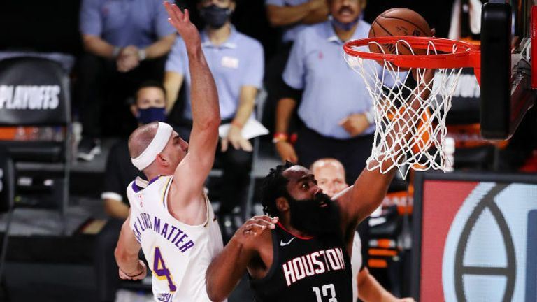 James Harden #13 of the Houston Rockets drives to the basket as Alex Caruso #4 of the Los Angeles Lakers defends during the second quarter in Game Five of the Western Conference Second Round during the 2020 NBA Playoffs at AdventHealth Arena at the ESPN Wide World Of Sports Complex on September 12, 2020 in Lake Buena Vista, Florida.