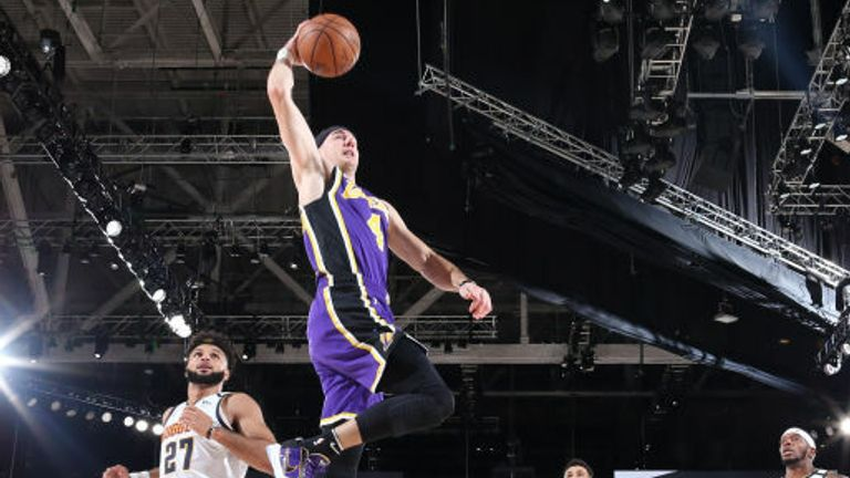 Alex Caruso #4 of the Los Angeles Lakers dunks the ball against the Denver Nuggets during Game Five of the Western Conference Finals of the NBA Playoffs on September 26, 2020 at AdventHealth Arena in Orlando, Florida.