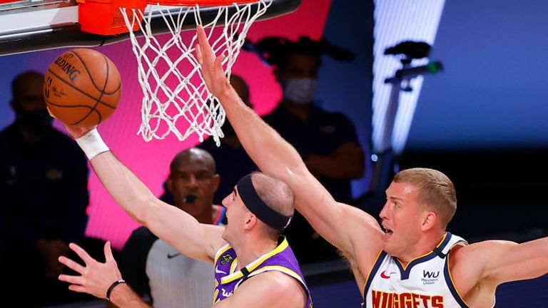 Alex Caruso #4 of the Los Angeles Lakers drives to the basket against Mason Plumlee #7 of the Denver Nuggets during the second quarter in Game Five of the Western Conference Finals during the 2020 NBA Playoffs at AdventHealth Arena at the ESPN Wide World Of Sports Complex on September 26, 2020 in Lake Buena Vista, Florida.