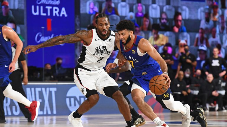 Jamal Murray #27 of the Denver Nuggets drives to the basket around Kawhi Leonard #2 of the LA Clippers during Game Five of the Western Conference Semifinals of the NBA Playoffs on September 11, 2020 in Orlando, Florida at The Field House.