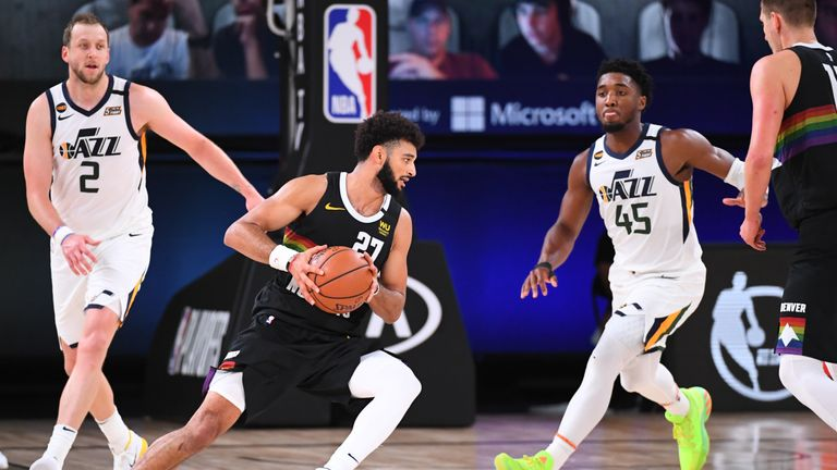 Jamal Murray #27 of the Denver Nuggets handles the ball against Donovan Mitchell #45 of the Utah Jazz during Round One, Game Seven of the NBA Playoffs on September 1, 2020 at the AdventHealth Arena at ESPN Wide World Of Sports Complex in Orlando, Florida.