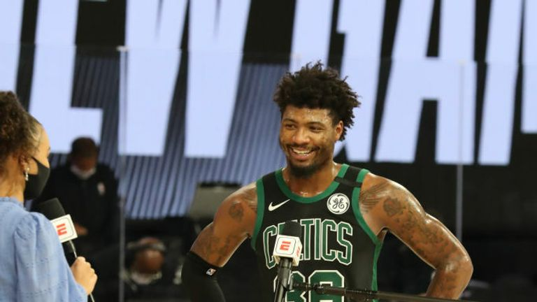 Marcus Smart #36 of the Boston Celtics gets interviewed after a game against the Toronto Raptors during Game Two of the Eastern Conference Semifinals of the NBA Playoffs on September 1, 2020 in Orlando, Florida at The Field House.